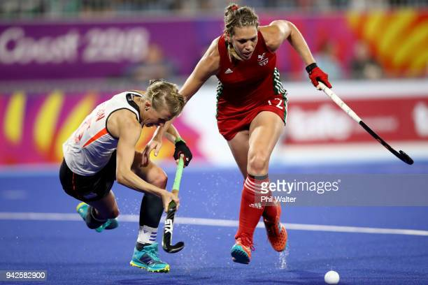 Alexandra Danson of England and Tina Evans of Wales contest the ball during their Womens Hockey match between England and Wales on day two of the...