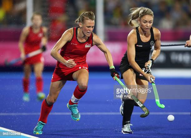 Alexandra Danson of England is challenged by Anita McLaren of New Zealand during Women's Semi Final Hockey match between England and New Zealand on...