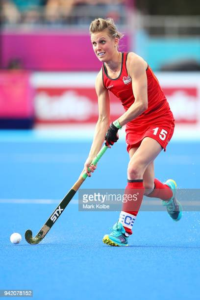 Alexandra Danson of England runs the ball forward during the Pool A Hockey match between South Africa and England on day one of the Gold Coast 2018...