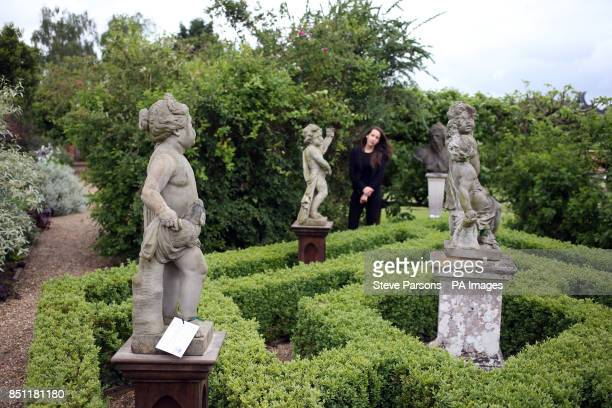 Alexandra Deyzac from Chrisite's checks some statues which are part of Dunsborough Park Garden Statuary from The Collection of Baron and Baroness...