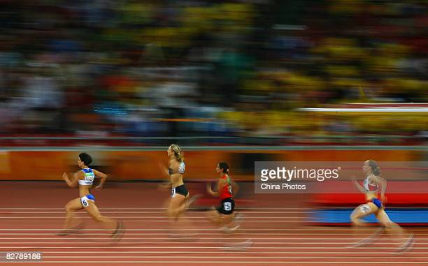 Alexandra Dimoglou of Greece Tetiana Smyrnova of Ukraine Sanaa Benhama of Morocco and Nantenin Keita of France compete in the Women's 400m T13 Final...