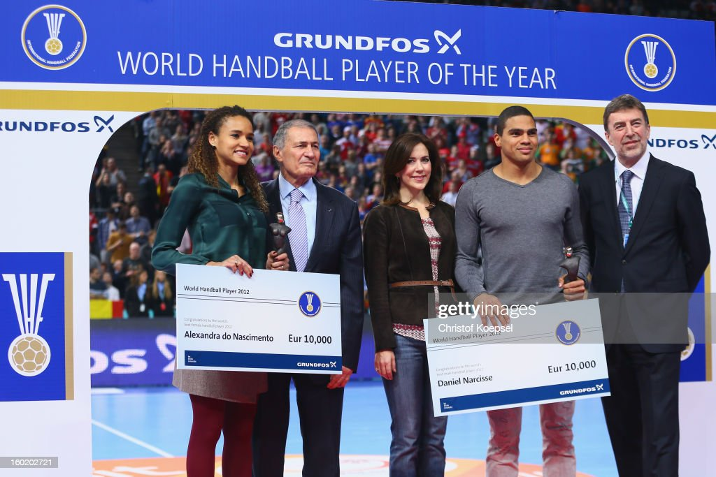 Alexandra do Nascimento of Brazil and Daniel Narcisse of France (2nd R) were votetd as the handball player of the year 2012 and awarded by Hassan Moustafa, president of the International Handball Federation IHF (2nd L), Crown Princess Mary of Denmark (3rd L) and Kim Klastrup, representative of IHF partner and awarding sponsor Grundfos (R) during the Men's Handball World Championship 2013 final match between Spain and Denmark at Palau Sant Jordi on January 27, 2013 in Barcelona, Spain.