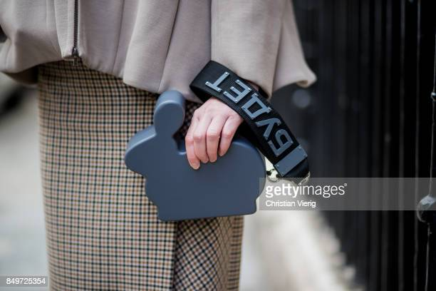 Alexandra Druzhinin wearing beige top pencil skirt Alexandra Druzhinin bunny bag Miu Miu shoes net tights during London Fashion Week September 2017...