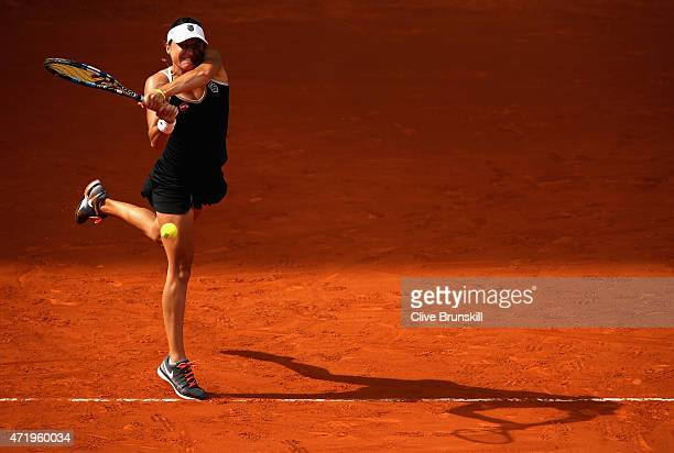 Alexandra Dulgheru of Romania in action against Ana Ivanovic of Serbia in their first round match during day one of the Mutua Madrid Open tennis...