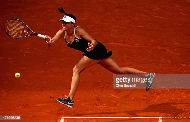 Alexandra Dulgheru of Romania plays a forehand against Ana Ivanovic of Serbia in their first round match during day one of the Mutua Madrid Open...