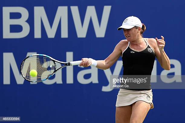 Alexandra Dulgheru of Romania plays a shot to Julia Goerges of Germany during the Quarter Finals on day five of the BMW Malaysian Open at the Royal...