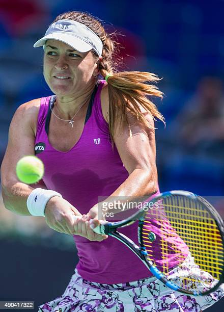 Alexandra Dulgheru of Romania returns a shot against Ana Ivanovic of Serbia during day two of the 2015 Wuhan Open at Optics Vally International...