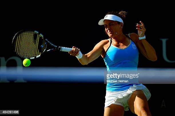 Alexandra Dulgheru of Romania returns a shot against Maria Sharapova of Russia during their women's singles second round match on Day Three of the...
