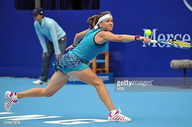 Alexandra Dulgheru of Romania returns a shot against Svetlana Kuznetsova of Russia during day one of the 2011 China Open at the National Tennis...