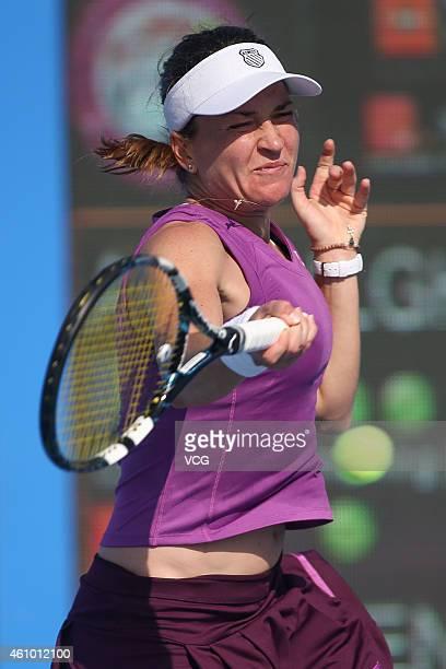 Alexandra Dulgheru of Romania returns a shot against Zheng Saisai of China on day one of the WTA Shenzhen Open at Longgang Sports Center on January 4...
