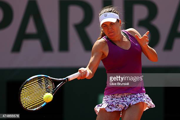 Alexandra Dulgheru of Romania returns a shot during her women's singles match against Alize Cornet of France during day four of the 2015 French Open...