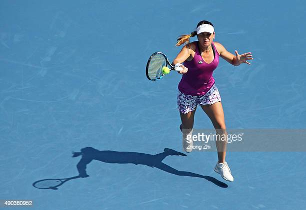 Alexandra Dulgheru of Romania returns a shot during the match against Ana Ivanovic of Serbia on Day 2 of 2015 Dongfeng Motor Wuhan Open at Optics...