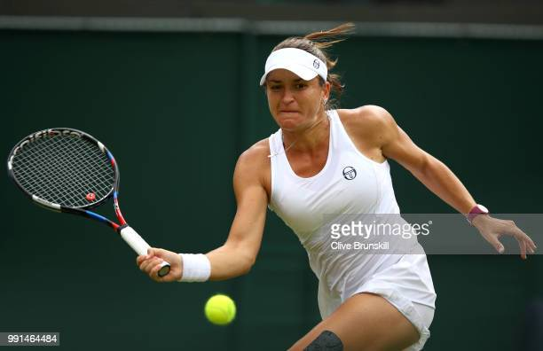 Alexandra Dulgheru of Romania returns against Venus Williams of The United States during their Ladies' Singles second round match on day three of the...