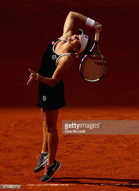 Alexandra Dulgheru of Romania serves against Ana Ivanovic of Serbia in their first round match during day one of the Mutua Madrid Open tennis...