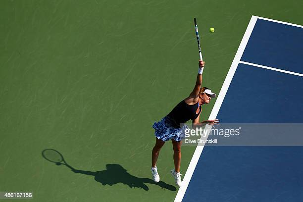 Alexandra Dulgheru of Romania serves against Angelique Kerber of Germany during their Women's Singles First Round match on Day Two of the 2015 US...