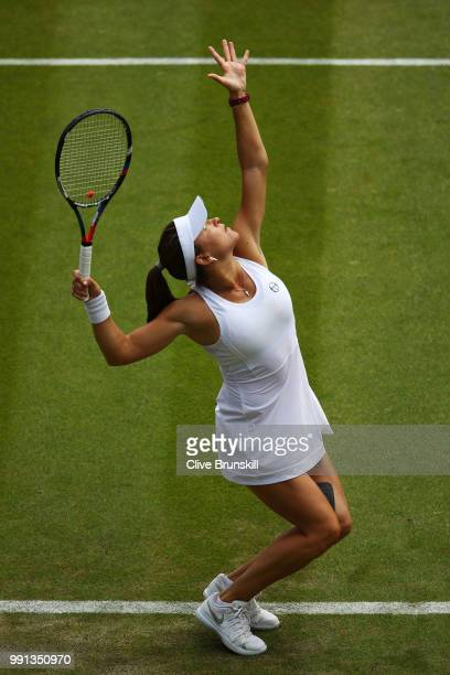 Alexandra Dulgheru of Romania serves against Venus Williams of The United States during their Ladies' Singles second round match on day three of the...