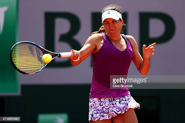 Alexandra Dulgheru of Romania serves during her women's singles match against Alize Cornet of France during day four of the 2015 French Open at...