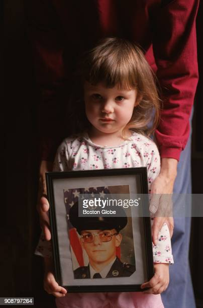 Alexandra Duquette 25 holds a photo of Henry Hudon her uncle who died at the Northampton Veteran's Hospital allegedly by nurse Kristen Gilbert