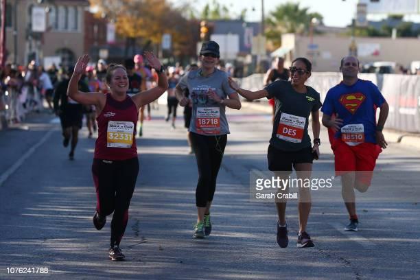 Alexandra Eagle and 2018 Boston Marathon Winner Desiree Linden run during the Humana Rock 'n' Roll San Antonio Marathon 1/2 Marathon on December 02...