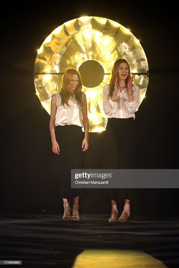 Alexandra Fischer-Roehler and Johanna Kuehll walk the runway after the Kaviar Gauche Show during Mercedes-Benz Fashion Week Spring/Summer 2014 at St. Agnes Church on July 3, 2013 in Berlin, Germany.