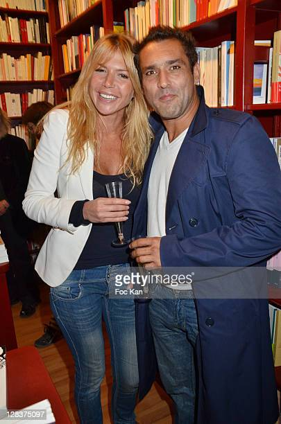 Alexandra Genoves and actor Jean Pierre Martins the 'Sophie a Cannes' Sylvie Bourgeois Book Launch Cocktail at L'Ecume des Jours on October 6 2011...