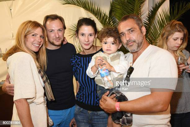 Alexandra Genoves Nicolas Cochin Pandora Demules baby and Jean Pierre Martins attend La Fete des Tuileries on June 23 2017 in Paris France