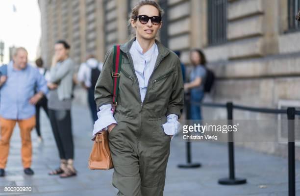 Alexandra Golovanoff wearing an olive jumpsuit outside Berluti during Paris Fashion Week Menswear Spring/Summer 2018 on June 23 2017 in Paris France