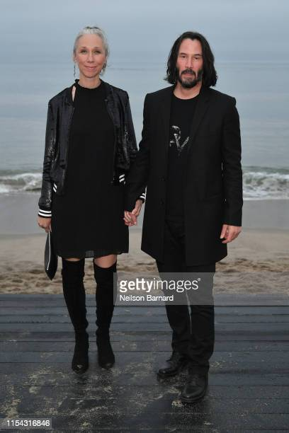 Alexandra Grant and Keanu Reeves attend the Saint Laurent Mens Spring Summer 20 Show Photo Call on June 06, 2019 in Malibu, California.