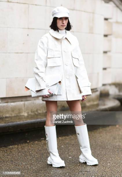 Alexandra Guerain is seen wearing a white Margiela outfit outside the Maison Margiela show during Paris Fashion Week: AW20 on February 26, 2020 in...