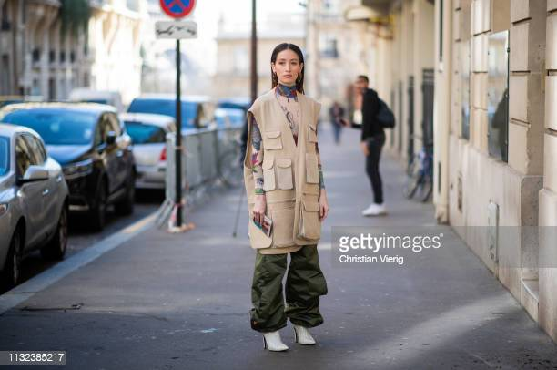 Alexandra Guerain is seen wearing beige vest olive pants outside Marques Almeida during Paris Fashion Week Womenswear Fall/Winter 2019/2020 on...