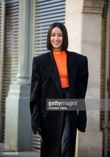 Alexandra Guerain seen wearing black coat, leather pants, orange top outside Heron Preston during Paris Fashion Week - Menswear F/W 2020-2021 on...