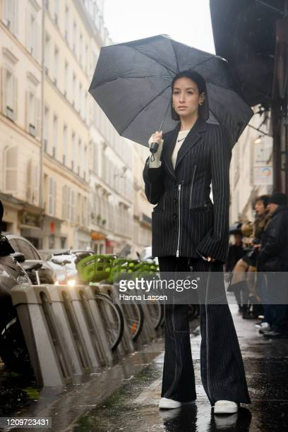 Alexandra Guerain wearing black pin striped suit nike shirt and white sneakers outside Thom Browne during Paris Fashion Week Womenswear Fall/Winter...