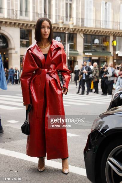 Alexandra Guerain wearing red patent trench coat outside Giambattista Valli during Paris Fashion Week Womenswear Spring Summer 2020 on September 30,...