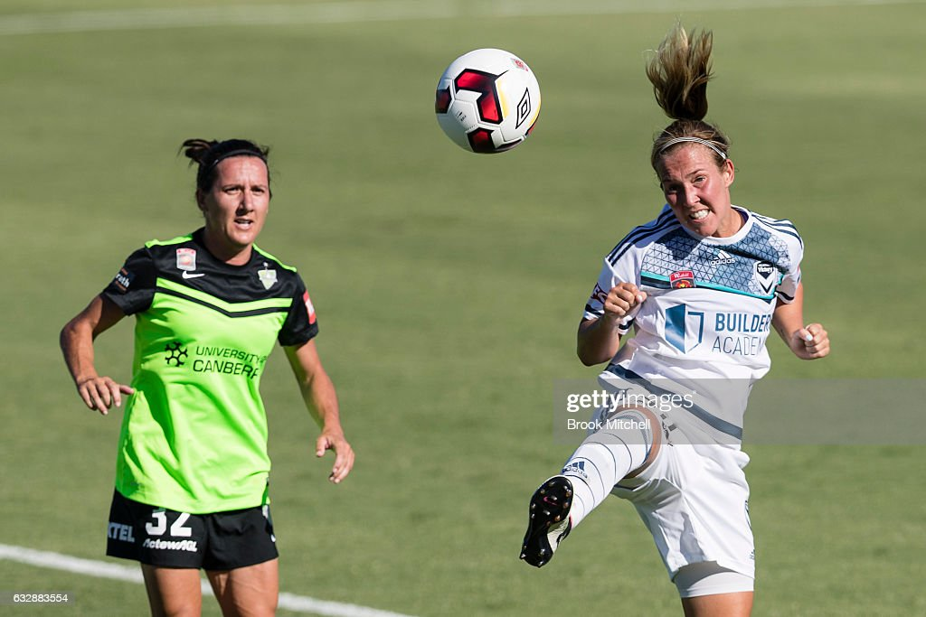 Alexandra Gummer of Melbourne Victory heads away against Canberra United's Lisa De Vanna during the round 14 W-League match between Canberra United and Melbourne Victory at McKellar Park on January 28, 2017 in Canberra, Australia.