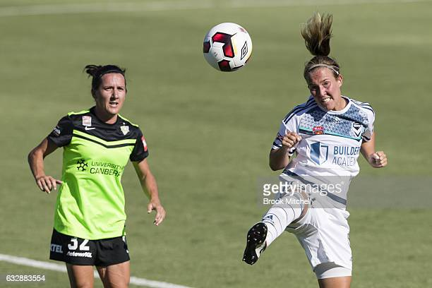 Alexandra Gummer of Melbourne Victory heads away against Canberra United's Lisa De Vanna during the round 14 WLeague match between Canberra United...