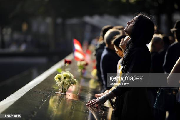Alexandra Hamatie whose cousin Robert Horohoe was killed on September 11 pauses at the National September 11 Memorial during a morning commemoration...