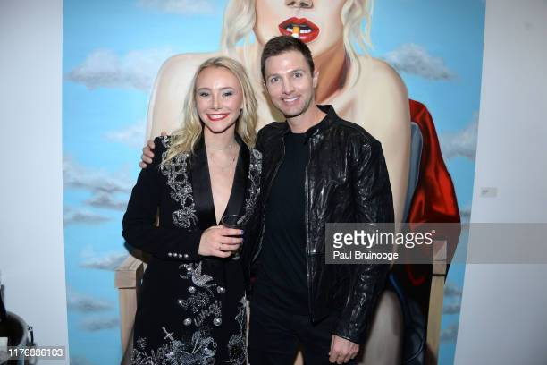 Alexandra Houx Grounds and David Roeske attend Delusions of the Wild Solo Exhibition By Alexandra Houx Grounds at 213 Bowery on October 17 2019 in...