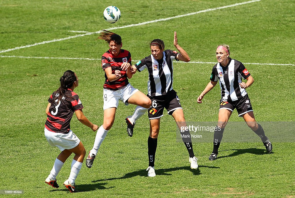 Alexandra Huynh and Vanessa Hart of the Wanderers contest possession with Stacey Day and Tiffany Boshers of the Jets during the round six W-League match between the Western Sydney Wanderers and the Newcastle Jets at Campbelltown Sports Stadium on November 25, 2012 in Sydney, Australia.