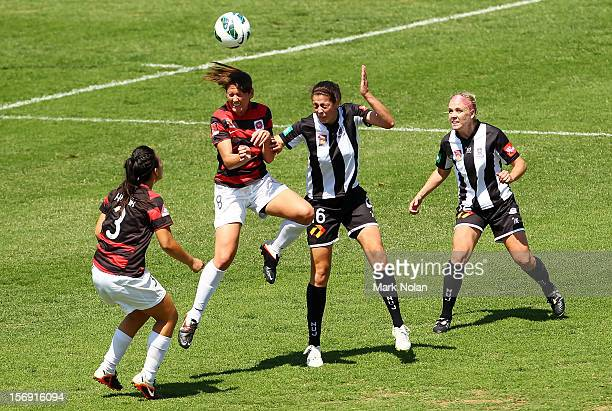 Alexandra Huynh and Vanessa Hart of the Wanderers contest possession with Stacey Day and Tiffany Boshers of the Jets during the round six WLeague...