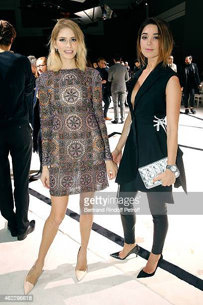 Alexandra Kirilenko and Elena Perminova attend the Giambattista Valli show as part of Paris Fashion Week Haute Couture Spring/Summer 2015 on January...