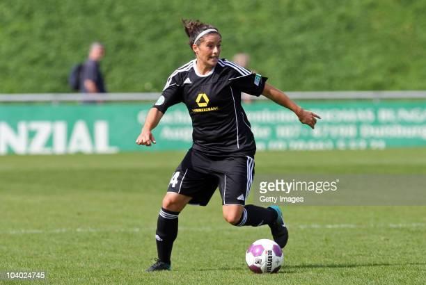 Alexandra Krieger of Frankfurt runs with the ball during the Women's bundesliga match between FCR Duisburg and FFC Frankfurt at the PCCStadium on...