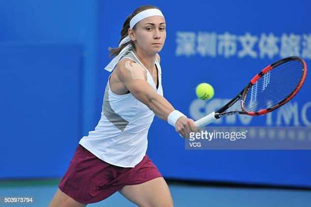 Alexandra Krunic of Serbia returns a shot with Cagla Buyukakcay of Turkey against Xu Yifan and Zheng Saisai of China in the Women's doubles semifinal...