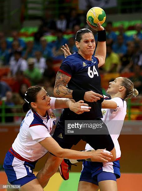 Alexandra Lacrabere of France tries to get by Daria Dmitrieva and Olga Akopian of Russia in the first half on Day 3 of the Rio 2016 Olympic Games at...