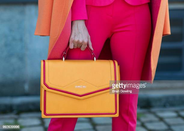 Alexandra Lapp bag detail poses during the Marc Cain Street Style shooting at WECC on July 3 2018 in Berlin Germany
