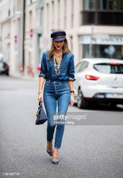 Alexandra Lapp is seen in an all denim look with Adriano Goldschmied ex-boyfriend jeans, the.nim denim blouse, JW Anderson denim Fisherman's cap,...