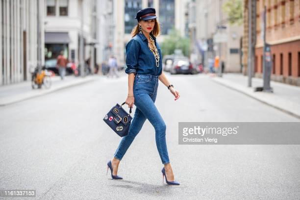 Alexandra Lapp is seen in an all denim look with Adriano Goldschmied exboyfriend jeans thenim denim blouse JW Anderson denim Fisherman's cap...