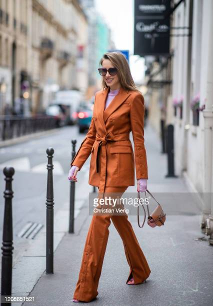 Alexandra Lapp is seen wearing a Altuzarra suit, Rejina Pyo Net Sustain Candice ribbed jersey top, Loewe Gate mini shoulder bag in brown, Gucci mules...