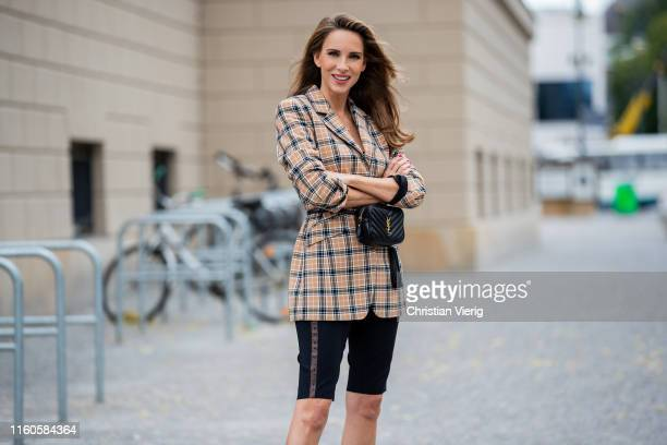 Alexandra Lapp is seen wearing a beige brown checkered blazer black cycling pants from Riani black St Laurent Lou belt bag during Berlin Fashion Week...
