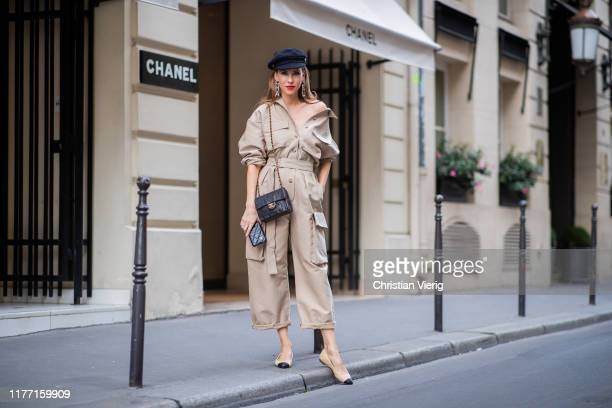 Alexandra Lapp is seen wearing a beige Frankie Shop jumpsuit, Chanel earrings, vintage Chanel classic bag, Chanel ballerinas, Chanel baker boy cap...