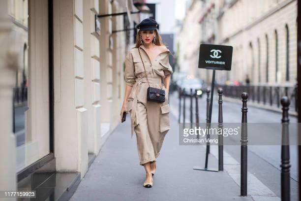 Alexandra Lapp is seen wearing a beige Frankie Shop jumpsuit Chanel earrings vintage Chanel classic bag Chanel ballerinas Chanel baker boy cap and...